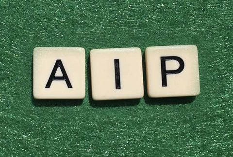 Scrabble tiles spelling out A I P