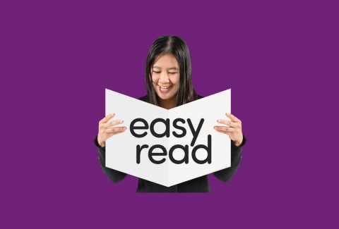 Lady holding a sign that says easy read