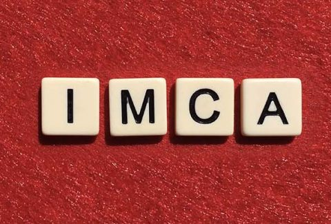 Scrabble tiles spelling out I M C A